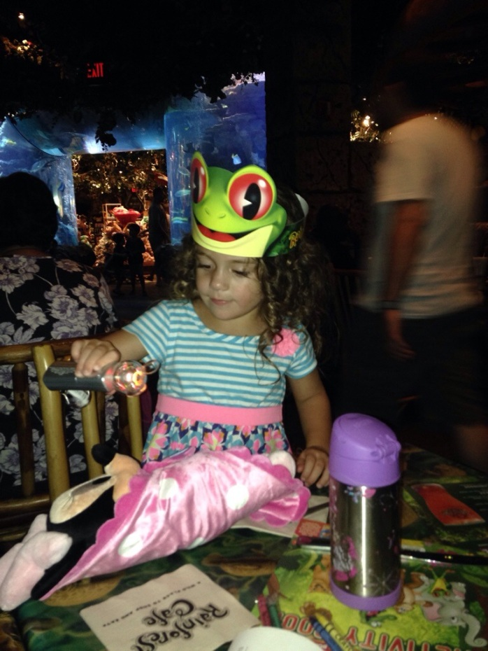 Alex was using her magic wand to protect Minnie from the terrifying animals at The Rainforest Café.