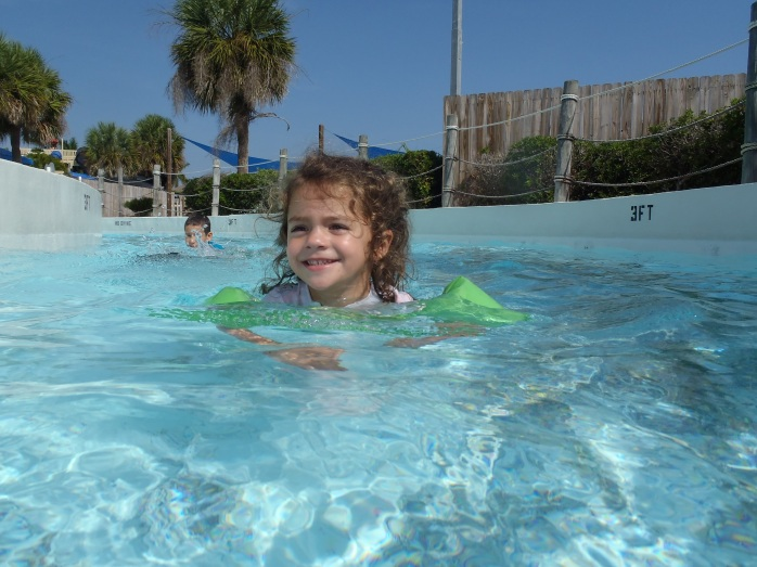 Alex's first trip around the lazy river! I want one of these going around m house!